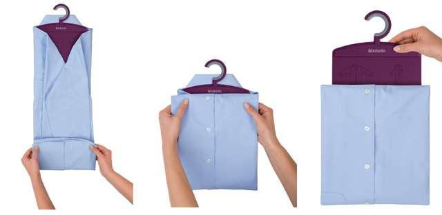 Подверните нижнюю часть рубашки и сложите ее пополам.